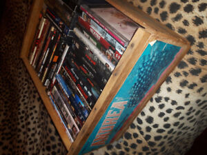 Dvd movies in old crate. Cds in old crate