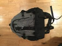 Unisex grey large backpack with many compartments a zips - excellent condition