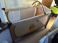 Winnie the Pooh travel cot with mobile £25