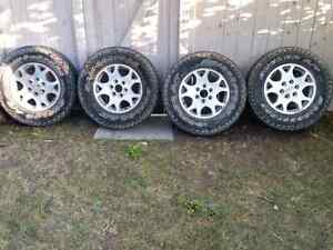 Gmc/chevrolet complete set of rims with tires.