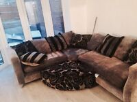 Beautiful large dfs corner sofa grey and black with swivel chair and foot stool