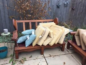 Wooden couch and love seat frames with cushions