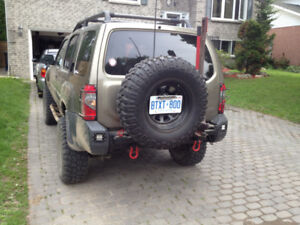 Looking for 2000-2004 Nissan Xterra Aftermarket Rear Bumper