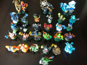 ABOUT 179 SKYLANDER FIGURES LEFT, 4 Wii GAMES, CARDS