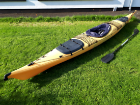 Sea kayak canoe with paddle and spraydeck