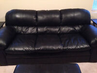 Black couch, love seat and ottoman