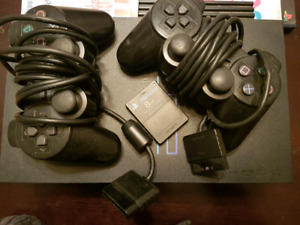 PS2 with 6 games and 2 controllers