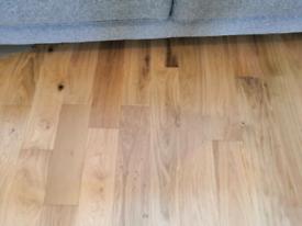 Nearly full pack of engineered wood floor in brushed oak