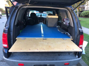 2002 Ford Explorer with bed and camping stuff