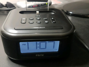 iHome Stereo Speaker /FM Clock Radio For iPhone with adapter.