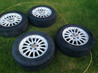 "Chrysler 4 rims mags 16""  Tire 3 are worn and hold air 1 is fla"