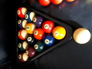 Pool balls, snooker balls,cues with brush and ball rack.
