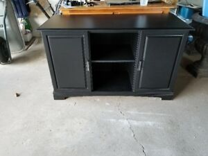 Black Cabinet. Can be used to hold a 75 gallon fish tank
