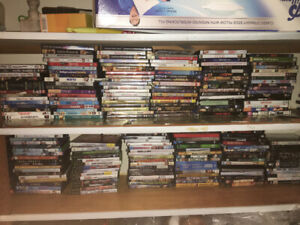 Over 250 DVDs and 15 video games for sale!!