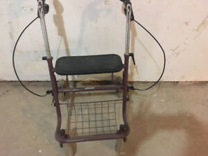 Assisted Device:  Walker with Seat and Storage Bin