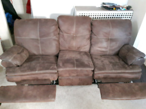 Matching reclining sofa and love seat.  Reduced to $450