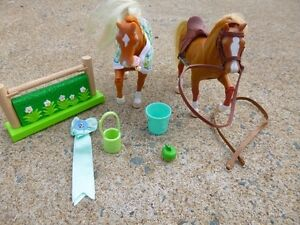 2 toy horses with accessories - saddle, reins, blanket, jump etc