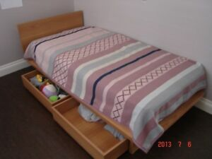 twin size bed with bedside table