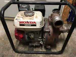 Honda gas water pump 2inch  in good condition with hose