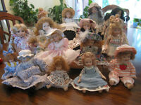 9 small porcelain dolls