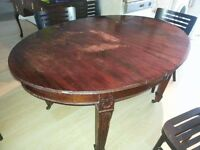 Antique extendable oval dining table with carved detail