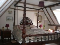 Beautiful double four-poster room to let in period home