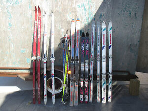 6 pairs of skis and poles and 2 pairs of boots