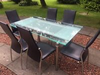 Extendable glass table and 6 chairs