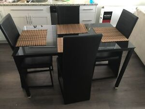 Good condition black dining room set with matching chairs.