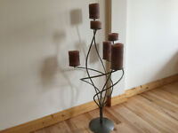 Brushed steel free-standing candlestick