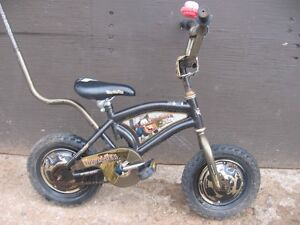 12 INCH DISNEY TOWMATER BIKE WITH TRAINING BAR. [FIRM]