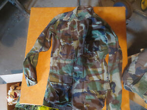vintage camouflage BDU military jacket and pants.