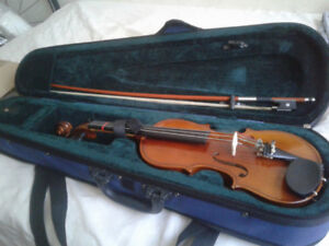 1/4 size violin with case.