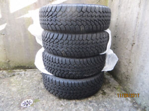 A like new set of Goodyear Nordic 215 60 16 tire for sale