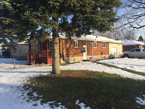 2+1BR BRICK BUNGALOW WITH CARPORT CONVERTED TO GARAGE
