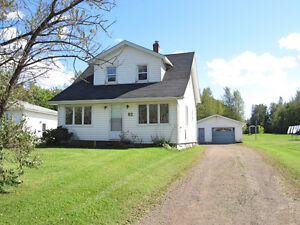 1.5 Storey home with garage and large lot