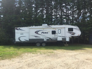 2013 puma fifth wheel with outdoor kitchen and rear bunk room