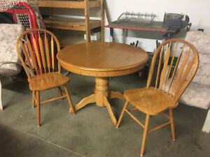 Oak round table and two chairs