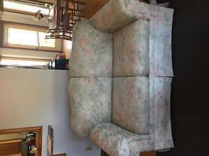 Free couch and wood shelf in OLDS