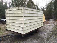 Enclosed trailer or shed or ice hut.