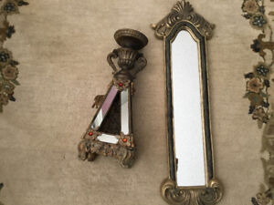 Wall mirror and candle stick