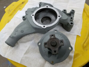 For sale. BB Dodge water pump housing and new pump. Excco