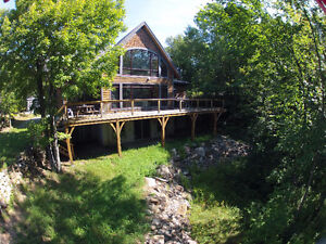 New Price! Custom timber frame on private 2 acres waterfront