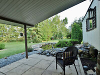 Renovated mobile with outbuildings on 8.53 private acres!
