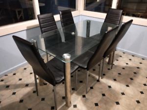 Glass top dining table and 6 leather look chairs