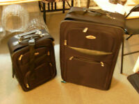 2 different size luggage black