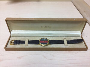 Men's Vintage Gold Gucci watch with lizard strap
