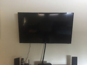 "43"" Seiki 1080p smart tv with accessories and wall mount"