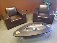 Two Large Leather Showroom Chairs