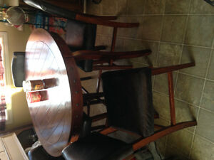 Pub style table with 4 leather back chairs